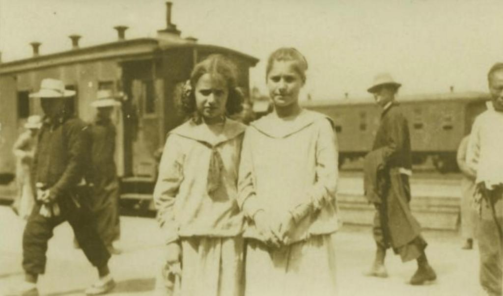 Slobodkina and her sister Tamara at the train station in Harbin en route to Vladivostok, May 1919.