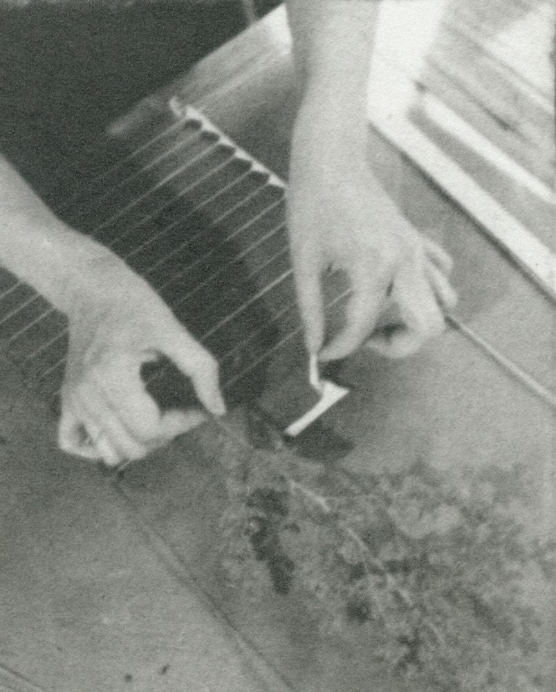 "Closeup of Slobodkina working on a ""glass sandwich."""